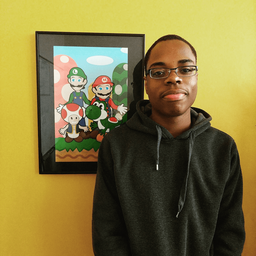 Guy standing next to super mariobros framed picture